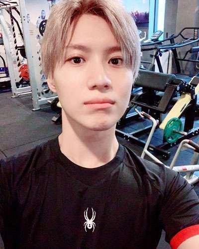 foto terbaru taemin super m di tempat gym